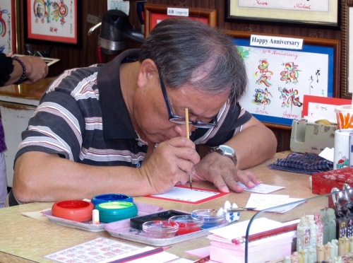 calligrapher at work in hong kong