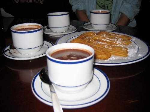 Chocolate and churros enjoyed with friends - photographed in Madrid