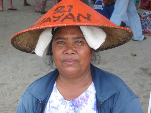 Saleswoman on the beach in Bali