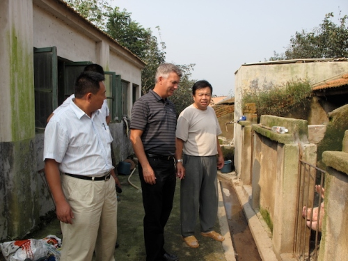 my brother with pig farmers in china