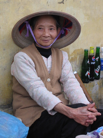 woman in saigon hat