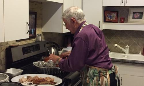 dad carves turkey