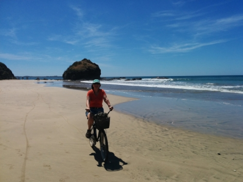 marylou biking on the beach