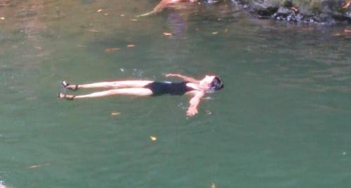 floating at the waterfall
