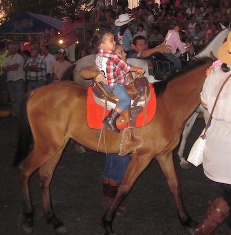 child on horse liberia