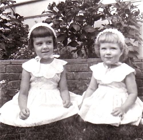 Easter 1957 - With my sister in dresses sewn by our mother