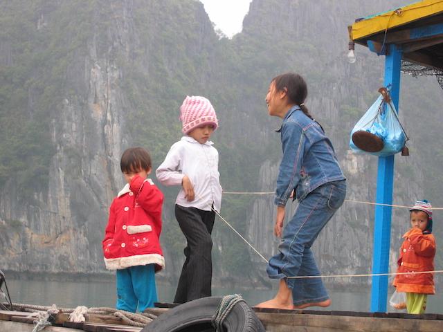 children on a boat in hailong bay vietnam