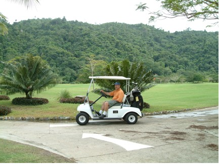 Dave on a golf course in Borneo