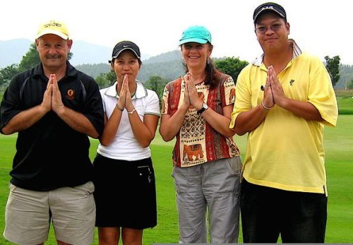 Dave and me with our golfing partners on a course in Thailand
