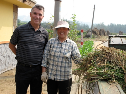 My brother learning about alternative farming methods from a Chinese farmer