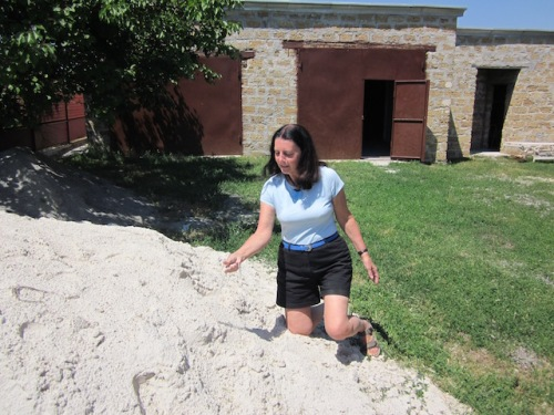 Here I am in a pile of white sand in Ukraine the kind of sand my great grandmother sprinkled on her floor in patterns to make her house beautiful