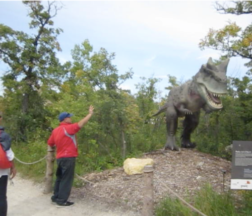 grandpa waving at dinosaur