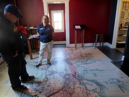 Dave stands on a map that shows just how linked by communication cables the world was already in 1901