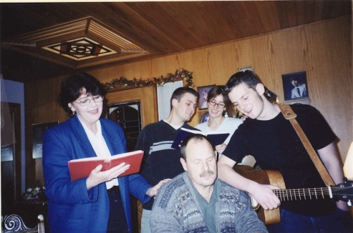 Singing Lo How A Rose with our family in 2002