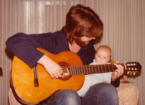playing guitar with baby