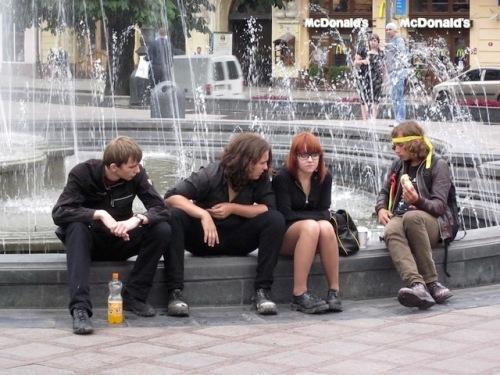 teens by a fountain in lviv (1)