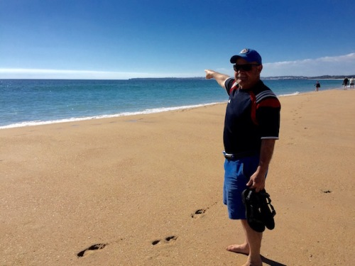 dave points down the beach