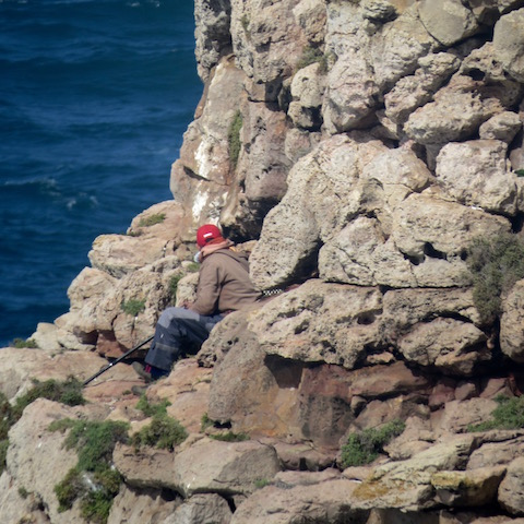 perched fisherman at fort sagres