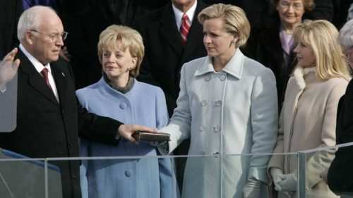 dick cheney's daughter mary holds bible for him when he is sworn in as vice president