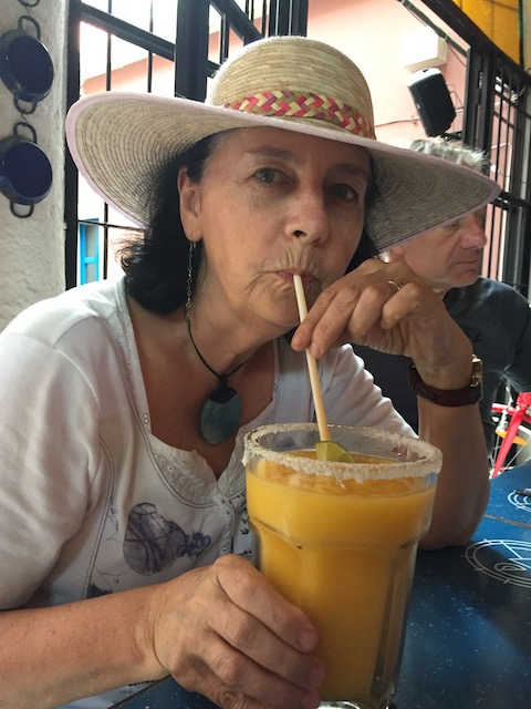 having a mango margarita in a new hat I just bought