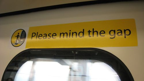 please mind the gap sign on a hong kong train By Andyhyleung wikipedia by